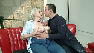 Whorish granny Norma gets intimate with one hot blooded young gay blade